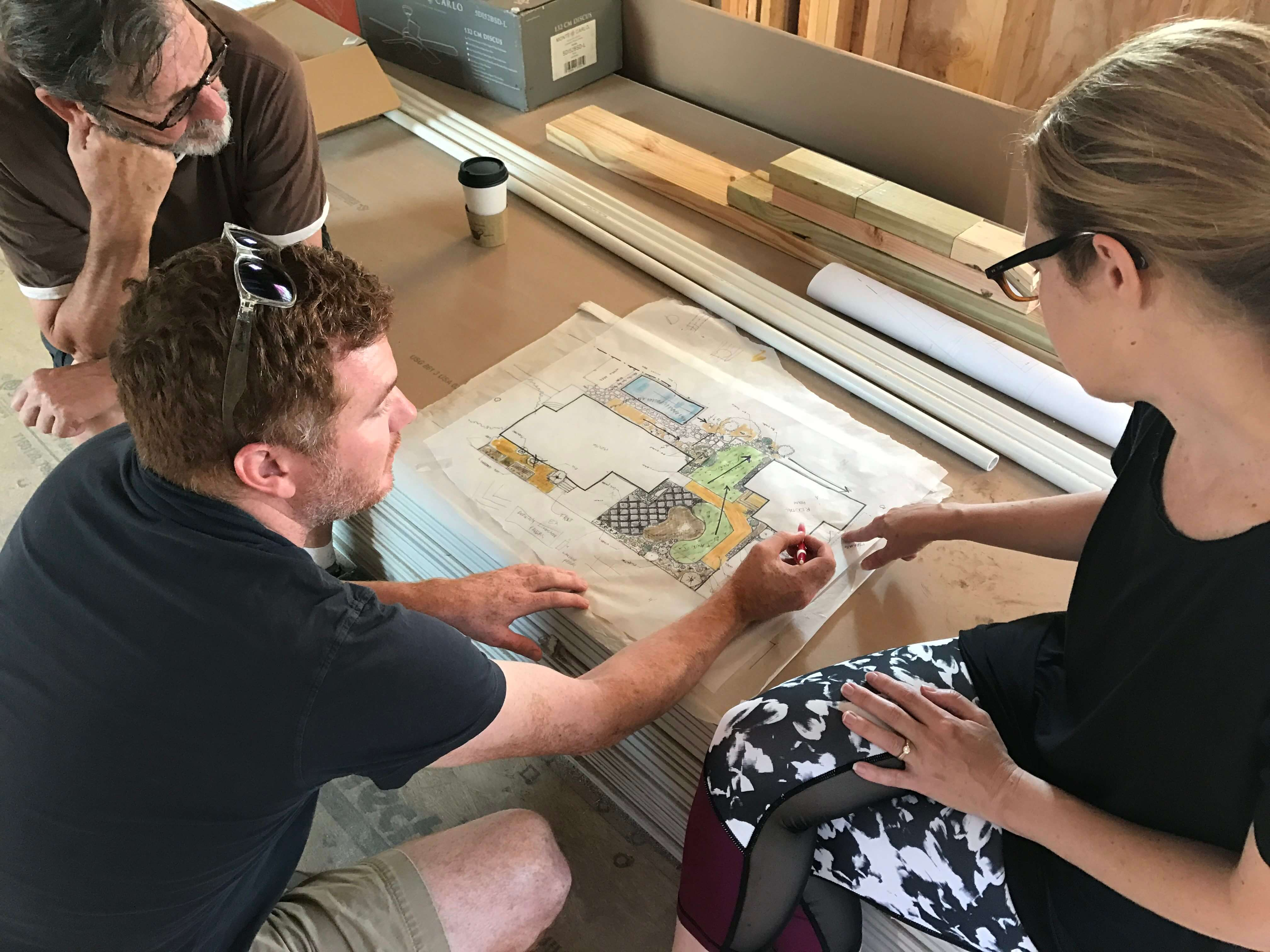 Adam Atkins and Christina Moon working on a landscape Design